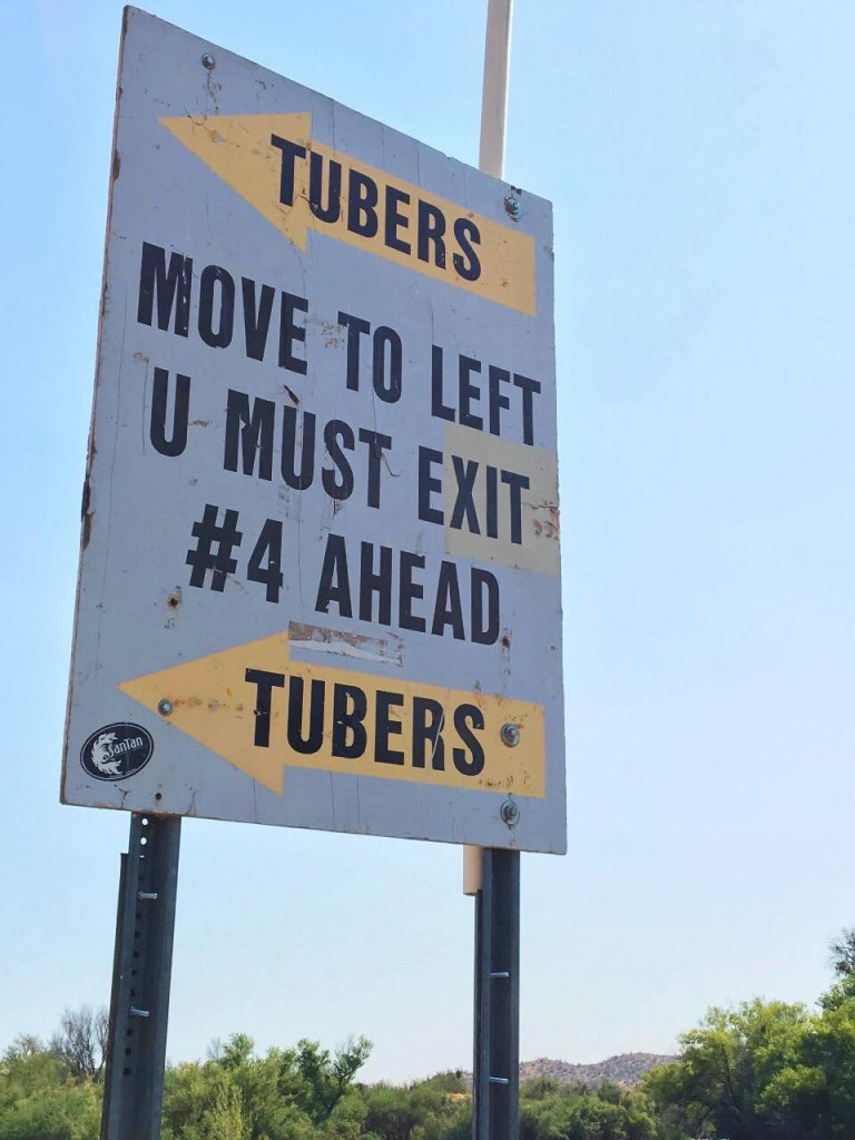A sign along the Salt River in Arizona urges tubers to move left and exit.