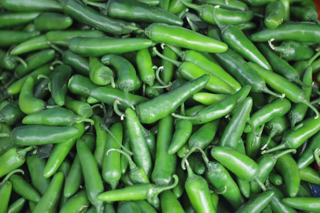 A pile of bright green chiles